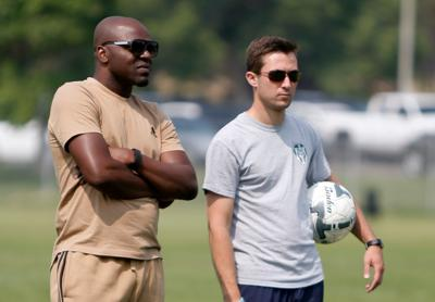 Didier Ndedi and assistant Nolan Trafton