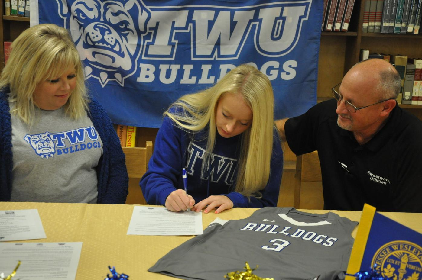 Barr-TWU signing with family