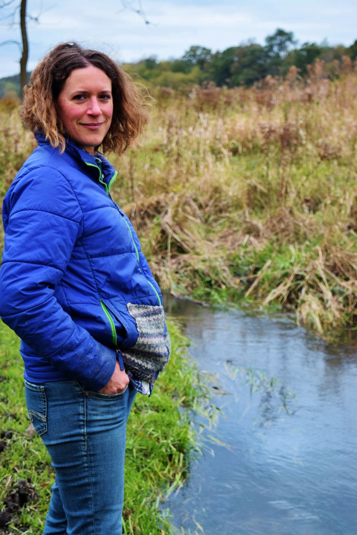 Brandi Bonde standing by stream