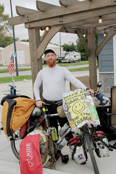 Cyclist spreading a message across the country