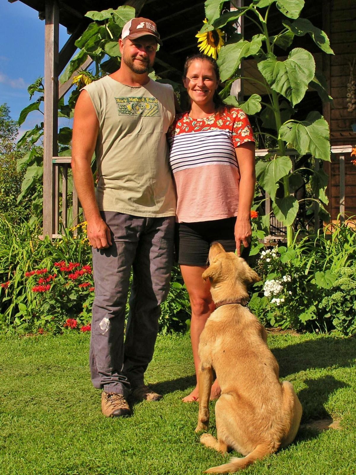 Todd and Kelsey Rothe with their dog, Sonny