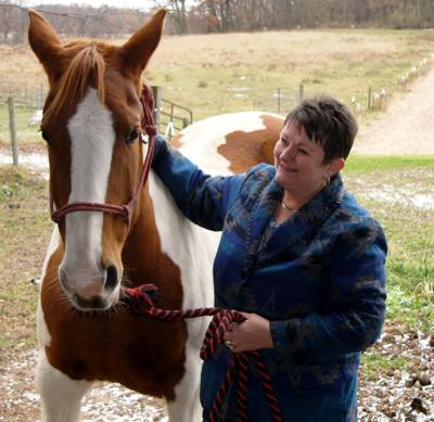 Kristi Schumacher spends time with her horse