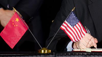 China US flags with hand signing agreement