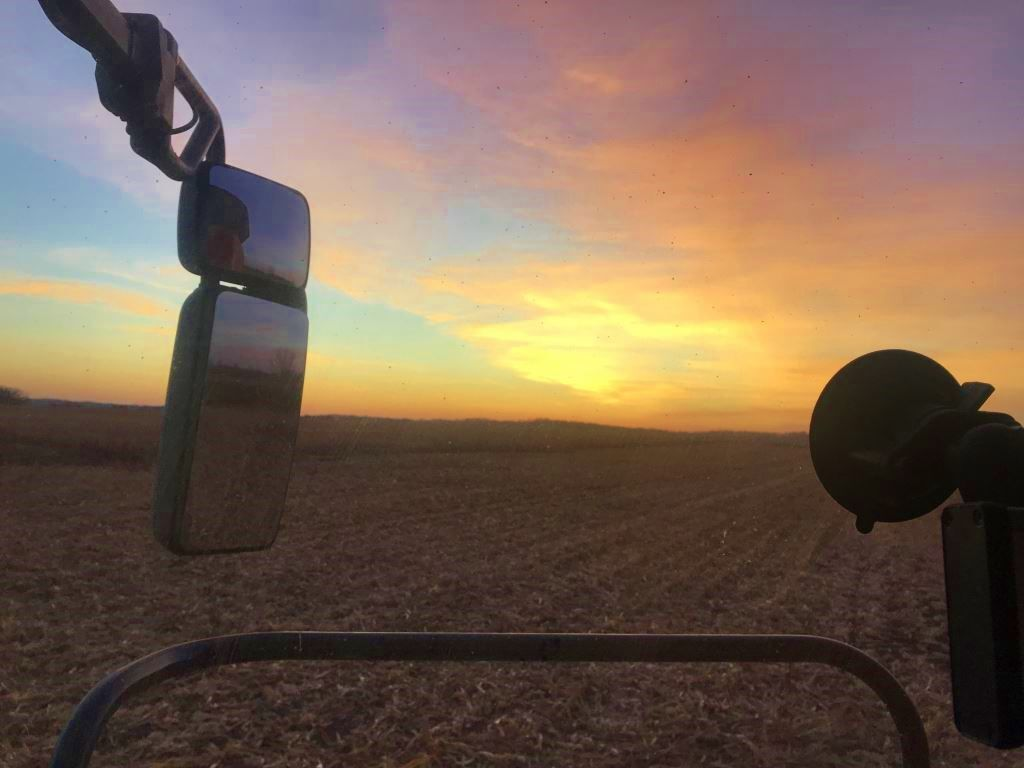 Colorful sunset while harvesting