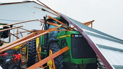 tractor is covered in debris from the derecho