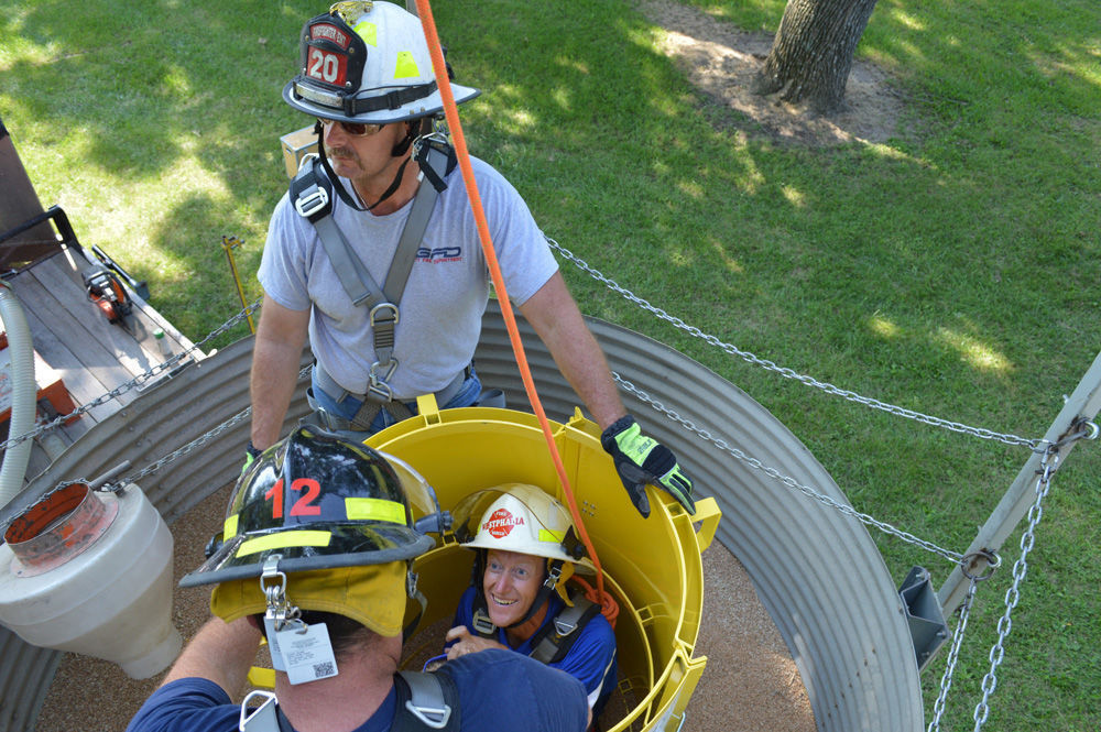 Fire fighters practice with grain-engulfment tube