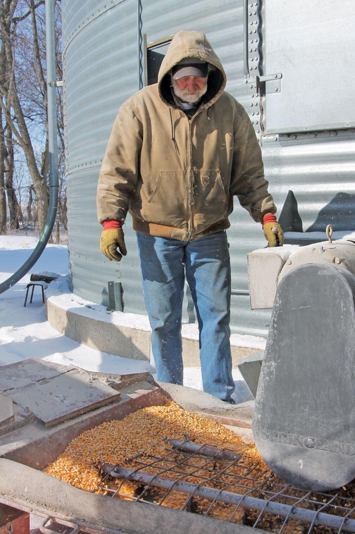 Keith Lovrien loads corn
