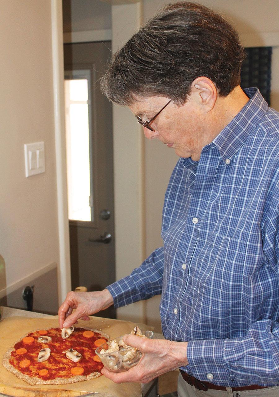 Helen Gunderson prepares a pizza