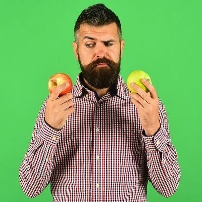 Man looks at fruit apples