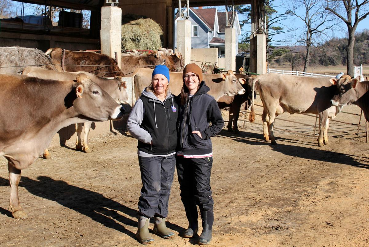 Barb and Amanda Lee with Brown Swiss cows