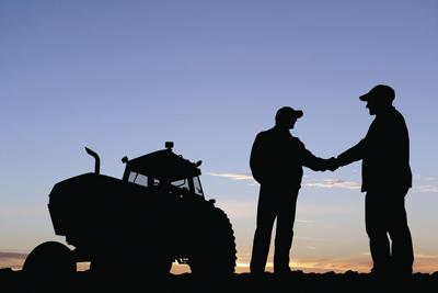 Farmer handshake outline on horizon