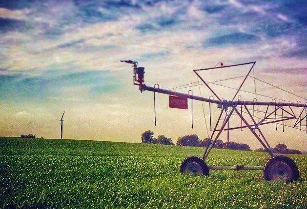 Irrigation pivot in field