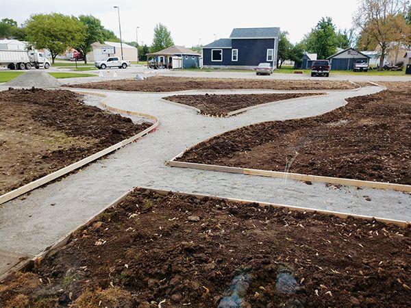 plaindealer pollinator garden concrete path