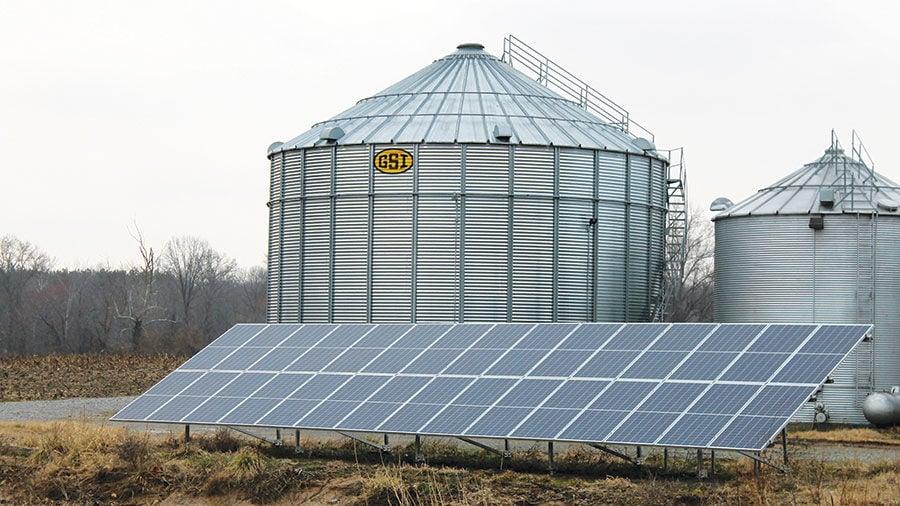 Solar panels provide electricity to grain bins