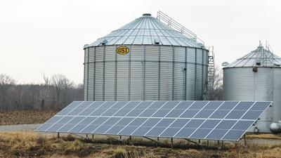 Solar panels provide electricity to grain bins