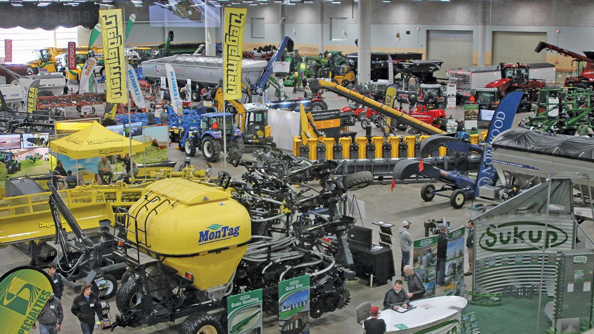 Farmers check out machinery at the Iowa Ag Expo