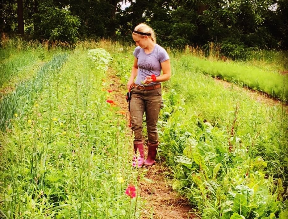 Bethanee Wright in field with flowers and vegetables
