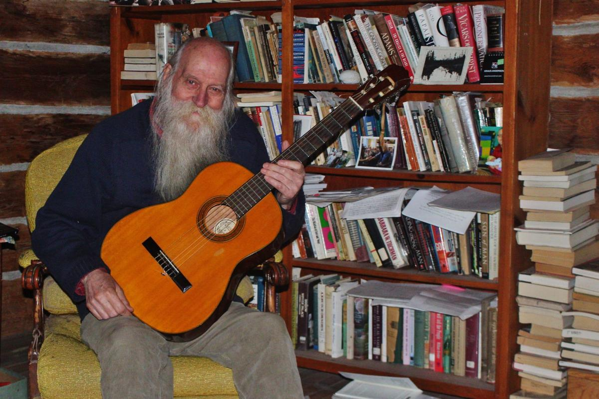 Paul Gilk with his guitar