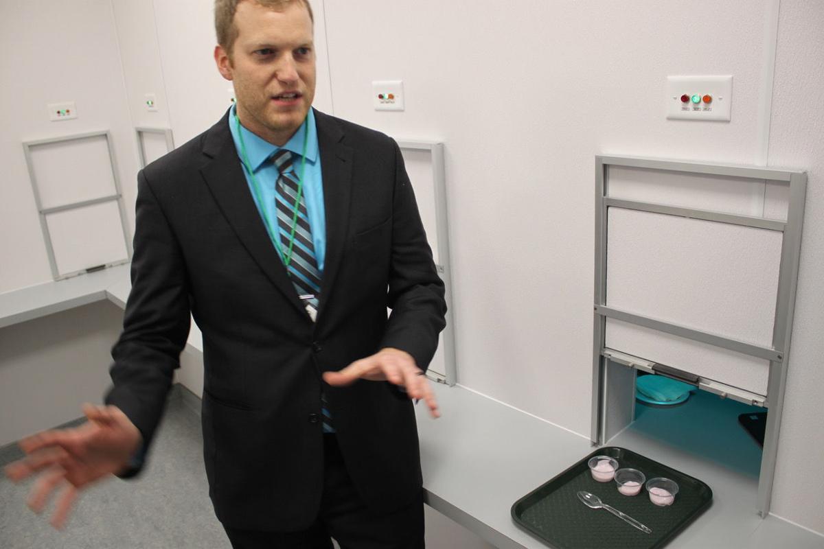 Ben Swanson, AURI food and nutrition scientist, shows the AURI/SMSU sensory lab staging area.