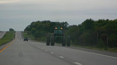 Twilight tractor on road