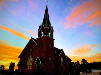 Dawn breaks over North Beaver Creek Church in rural Ettrick, Wisconsin.