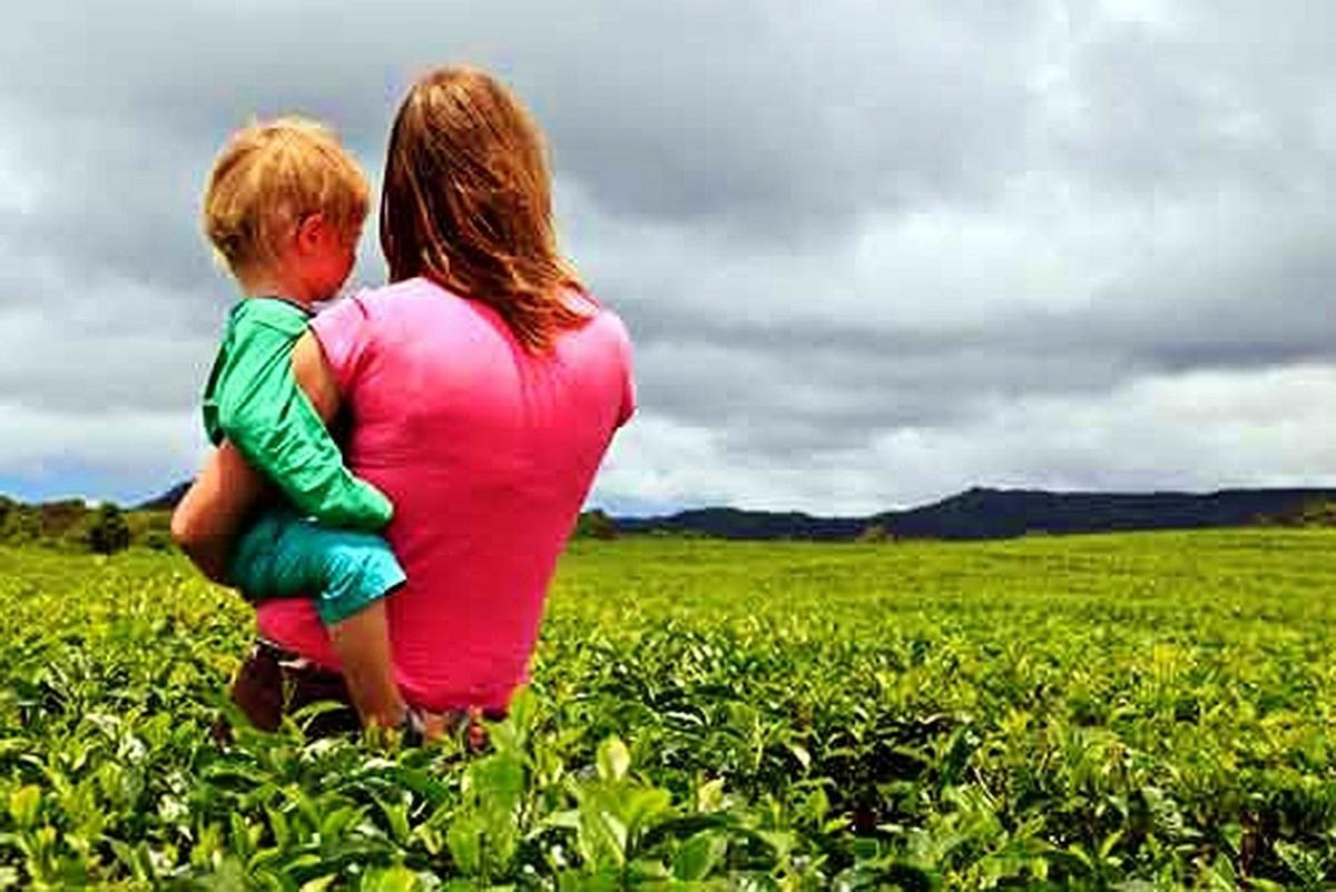 Women in field with child