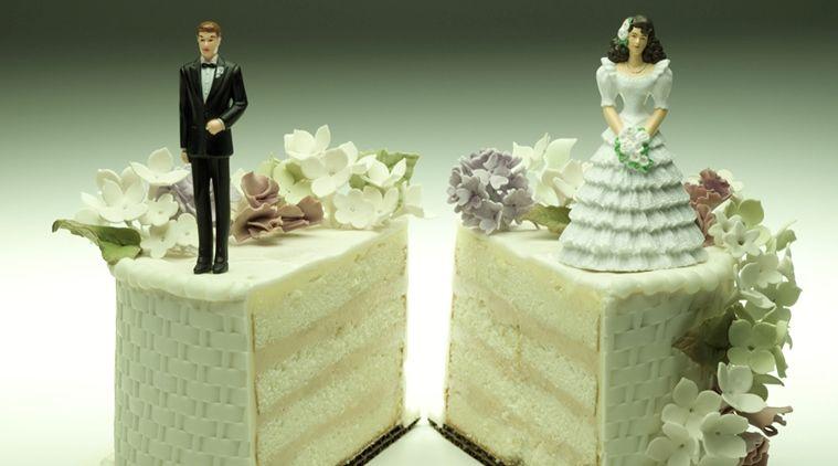 Bride and groom figurines on separate slices of wedding cake