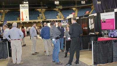 Pig farmers networking at Illinois Pork Expo