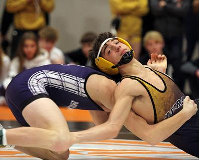 Three hearts and a long streak all broken at district wrestling tourney