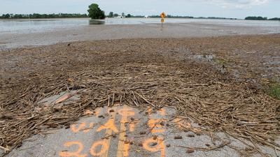 Floodwaters cover a Saline County field at Grand Pass