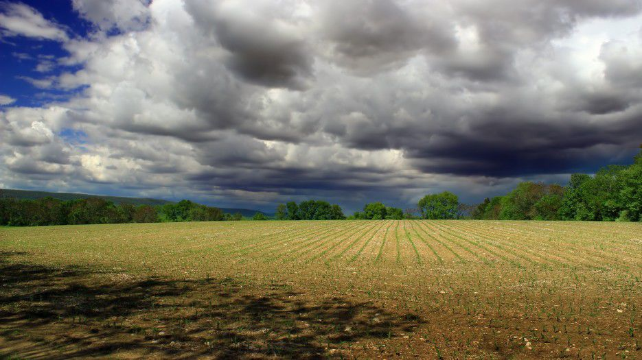 Farm land with clouds