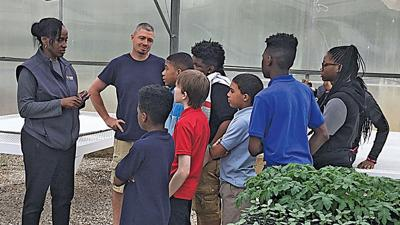 Jackie Joyner-Kersee discusses a greenhouse