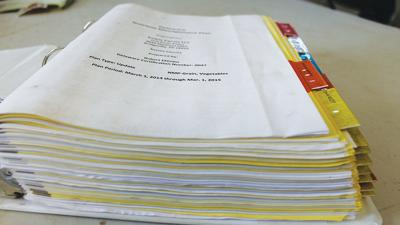 nutrient management laws and piles of paperwork