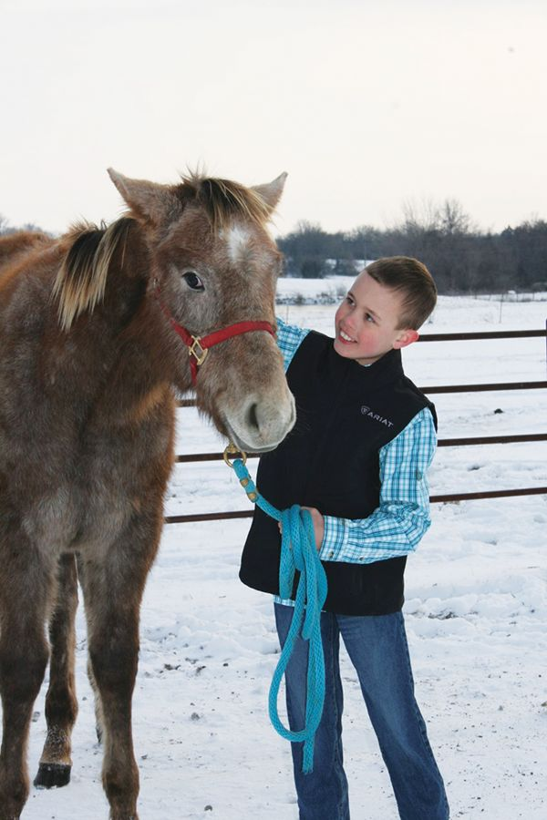 Excited fourth grade cowboy writes winning story about getting new horse