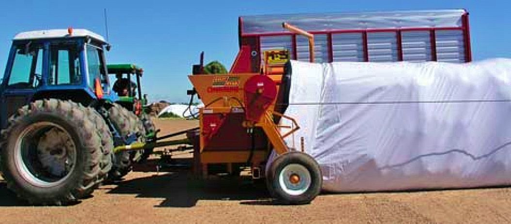 Tractor with feed storage in bag