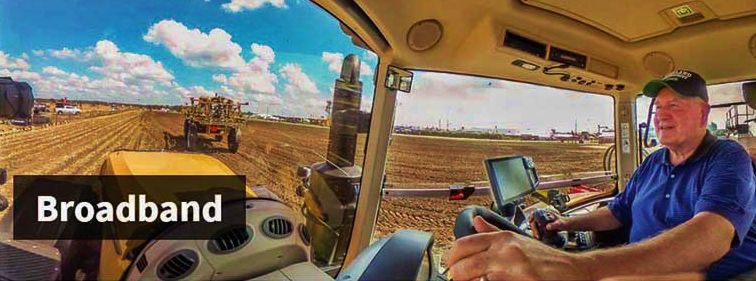 Secretary Perdue in tractor cab with precision ag technologies
