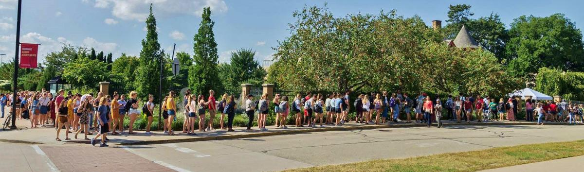 Students stand in line at Plant Adoption Day