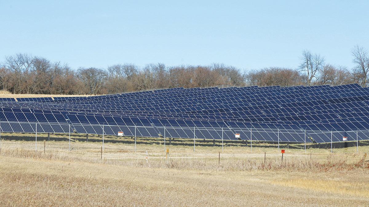 Solar panels cover a field in western Iowa
