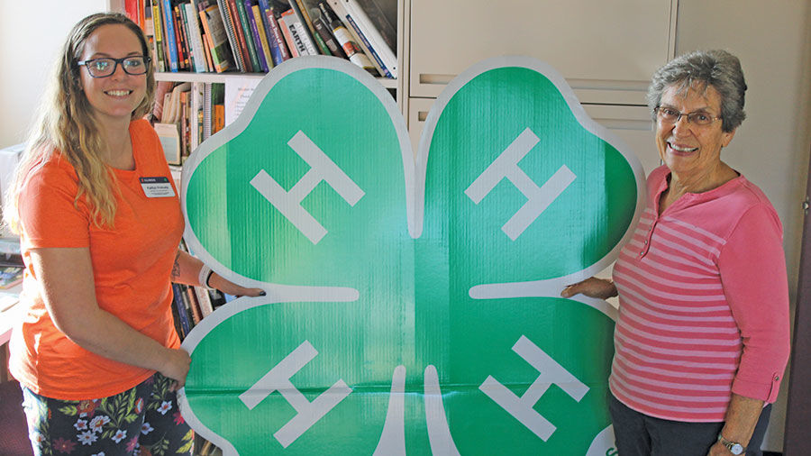 4-H symbol with Jeanie Wager of the Mohr family