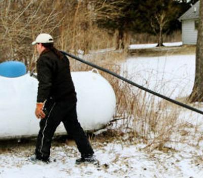 Supplier fills propane tank