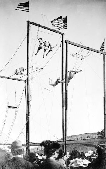 An outdoor trapeze show is held at the 1910 Dunn County Fair