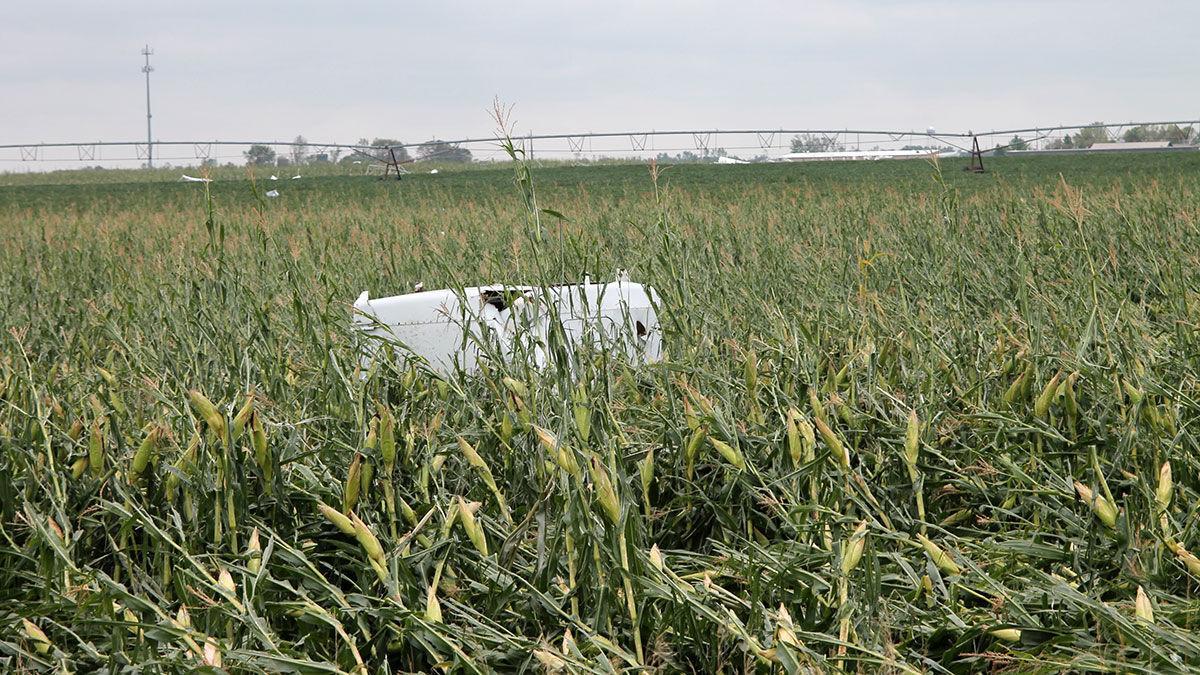 Debris sits in a wind-flattened cornfield in central Iowa