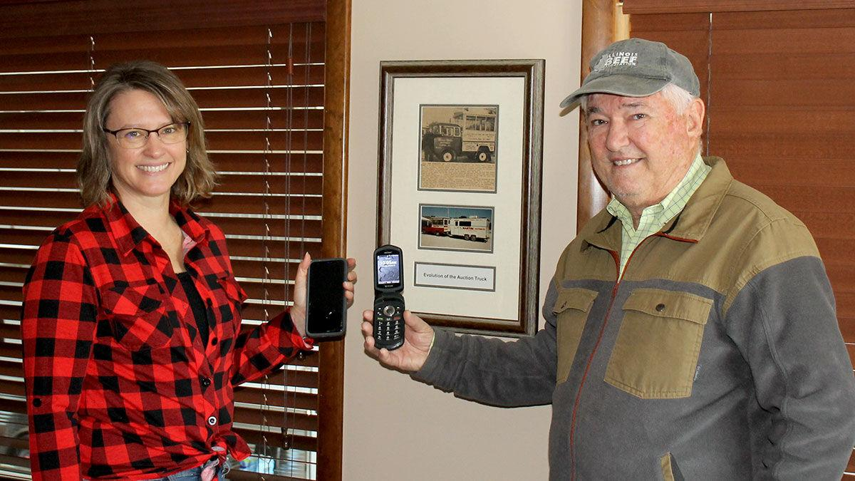 Lucy Nord and her father, Larry Martin, compare cells phones
