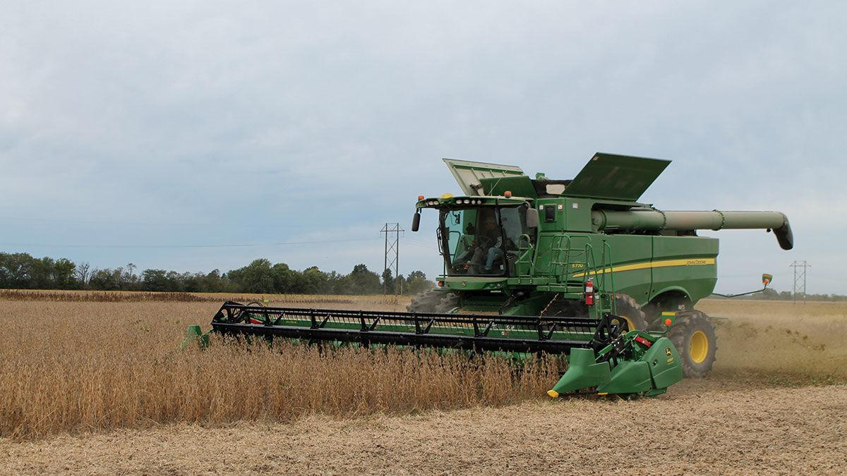Greg Rush harvests a field of soybeans