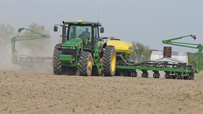 Dave Ibendahl crosses a field with his planter