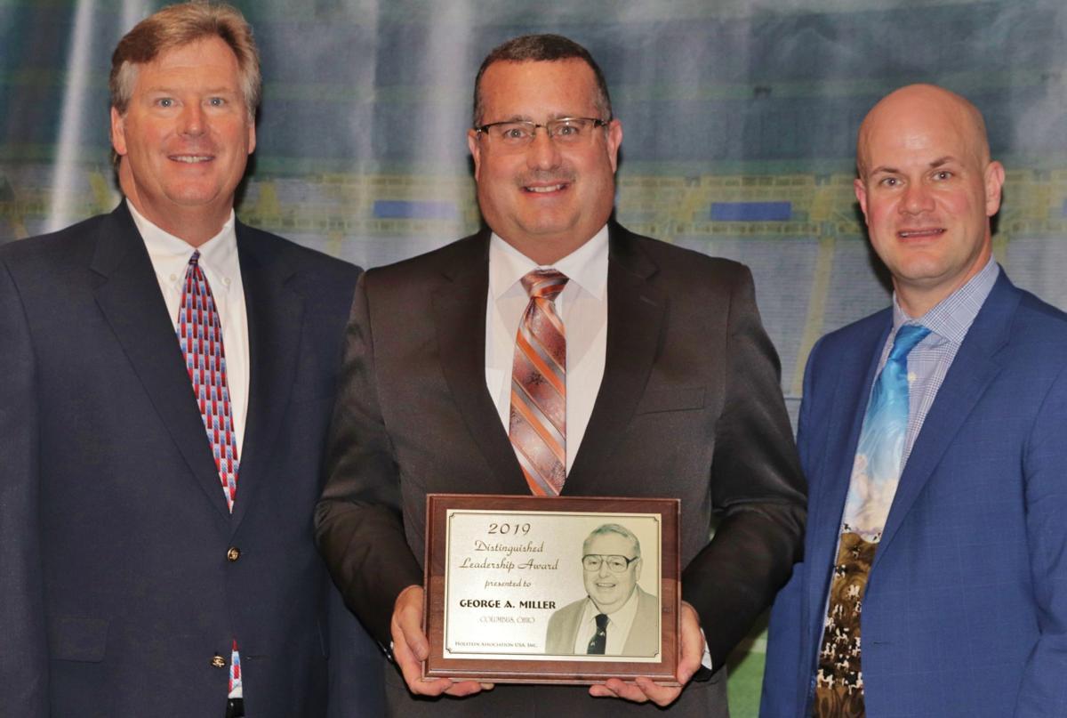 Ziegler accepting award on behalf of Miller