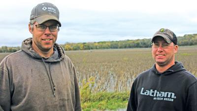 Caleb Akin and Noah Wendt flooded soybean field