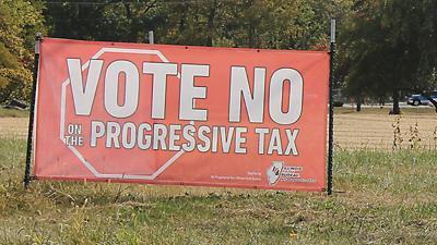 Illinois vote no tax sign