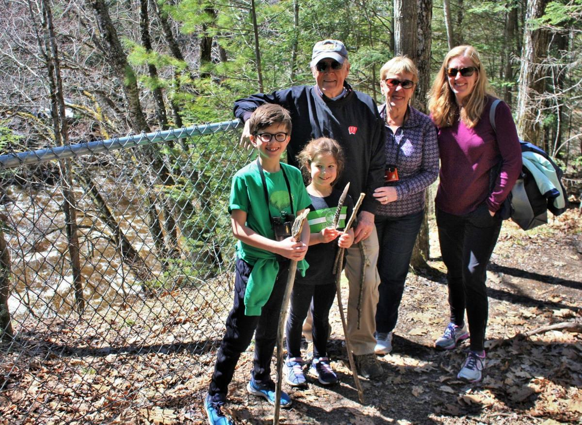 From left William Zuckerman, 10, and Mary Zuckerman, 7, of Madison, Wisconsin, visit Dells of Eau Claire County Park with their grandparents, David and Mary Aughenbaugh of Wausau, Wisconsin, and mother, Kate Zuckerman of Madison