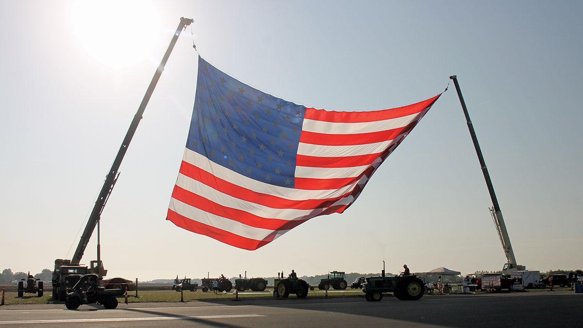 flag flies over the Half Century of Progress antique tractor show